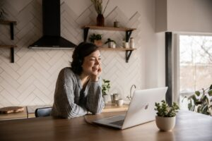 woman smiling while on virtual relationship coaching session